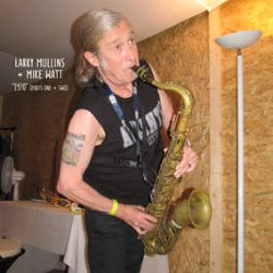 """Larry Mullins + Mike Watt - """"1970"""" (I / II): A tribute to The Stooges (7"""") - Mullins and Watt played together in the recent Stooges, and this is their take on the classic 1970, divided into two parts. <br> (RSD090)"""