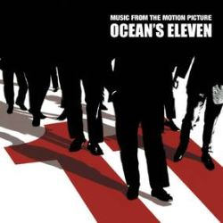 """Various Artists - Ocean's Eleven - Music From The Motion Picture (LP) - Cannily blending composer David Holmes' electronica jazz-funk with old-school orchestral artists like Percy Faith, Arthur Lyman, and Quincy Jones--not to mention a vintage Vegas shot of Elvis--the soundtrack to the 2001 thriller Oceans Eleven is like the overstuffed olive in Steven Soderbergh's cinematic cocktail. For its vinyl debut on its 20th anniversary, Real Gone Music is spinning this platter the only way it could be spun: on cornetto, red and black """"roulette wheel"""" vinyl limited to 2500 copies. Comes inside a jacket and printed inner sleeve sporting production stills.  (RSD2171)"""